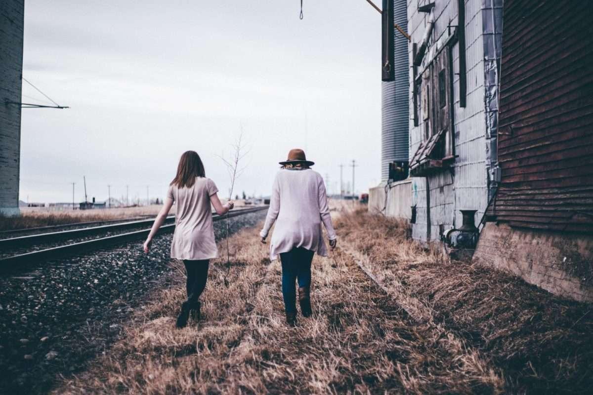 Married and single friend walking